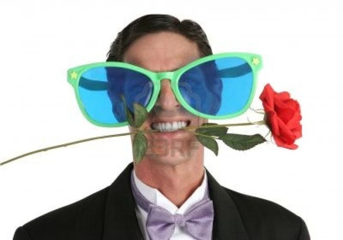 299015-a-man-in-a-tuxedo-with-a-rose-in-his-mouth-and-oversized-sunglasses